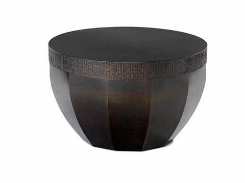 Image of a bronze circular drum shaped table.