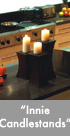 Thumbnail image of three bronze candlestands.