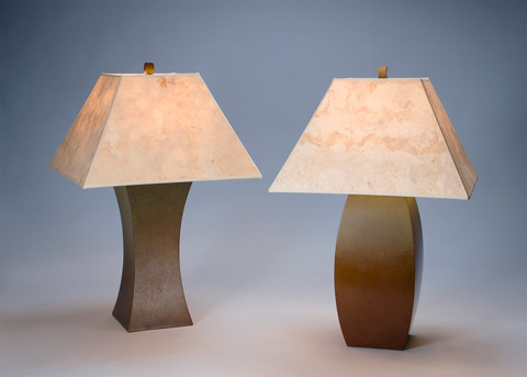 Image of three bronze table lamps.