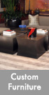 Thumbnail image of four custom bronze tables.