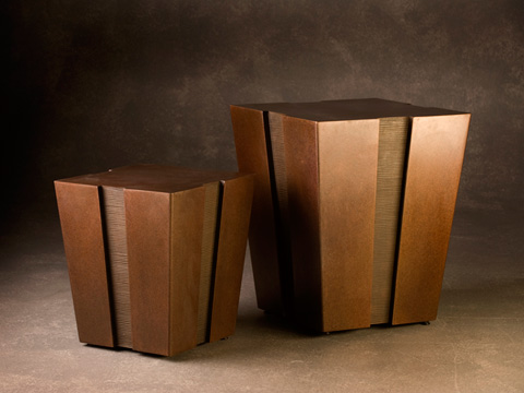 Image of two bronze tables with notches up the side.