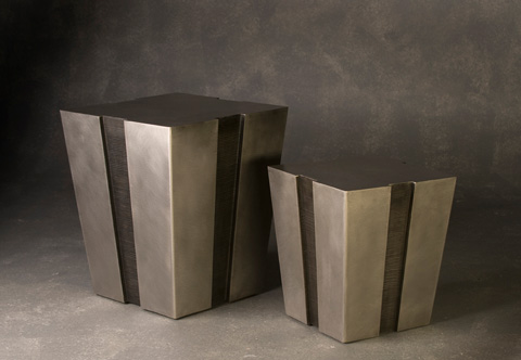 Image of two stainless steel tables with notches up the side.