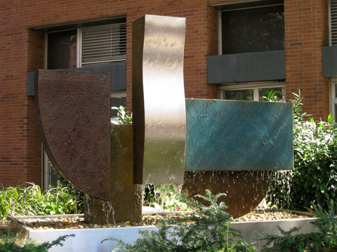Image of large bronze and stainless steel water feature.