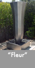 Thumbnail image of a large stainless steel water feature.