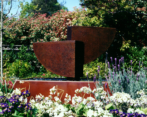 Image of a large bronze and stainless steel water feature.